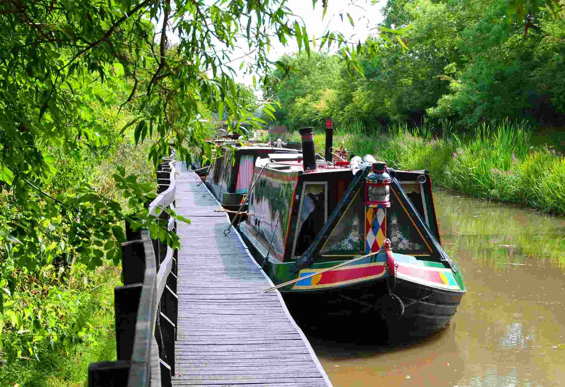 narrowboats docked by canal