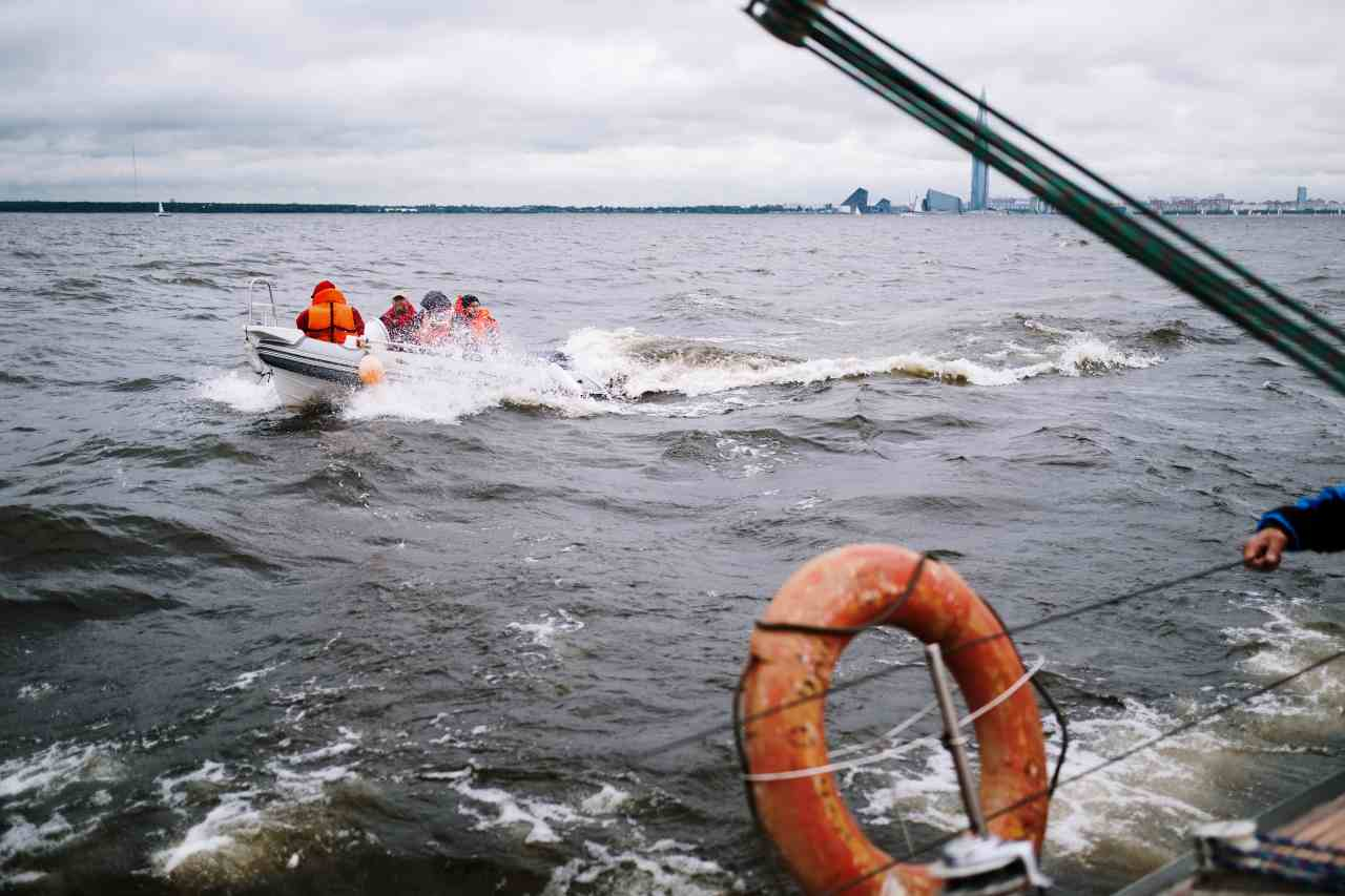 family on sinking boat