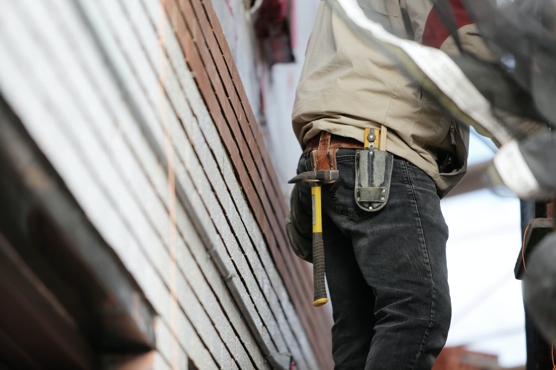 man holding tools