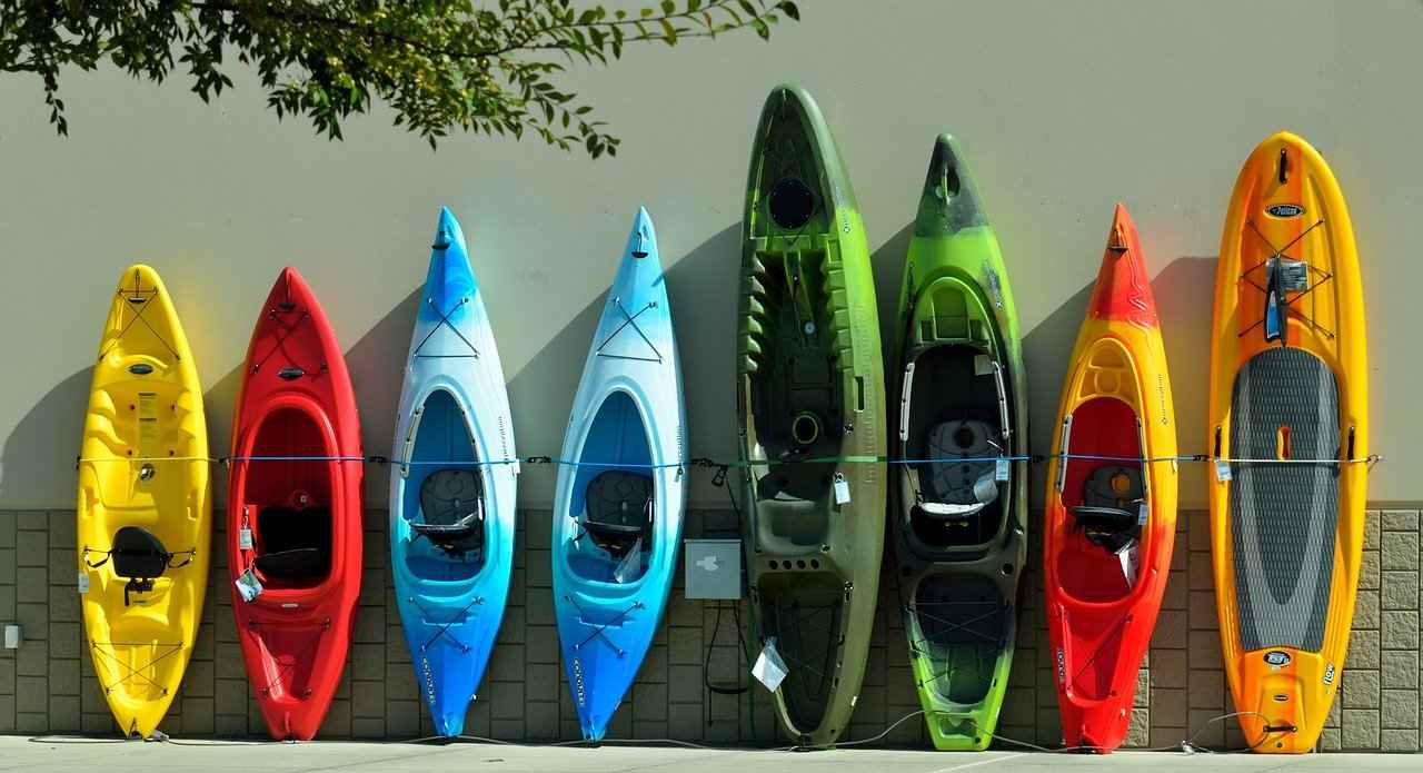 line of kayaks against wall