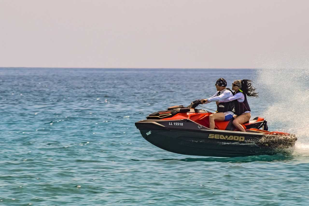 man and woman jet skiing