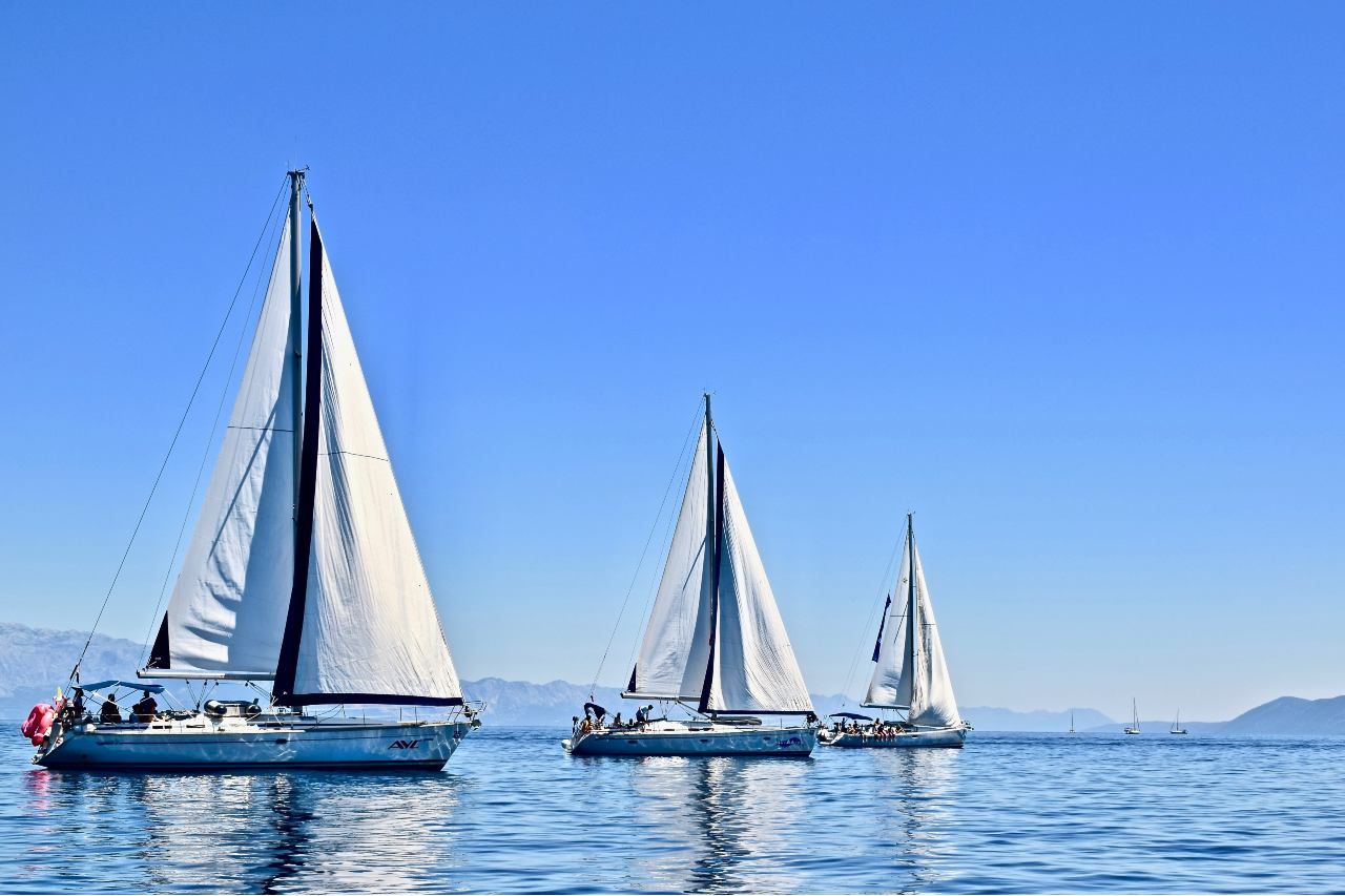 three sailing yachts at sea