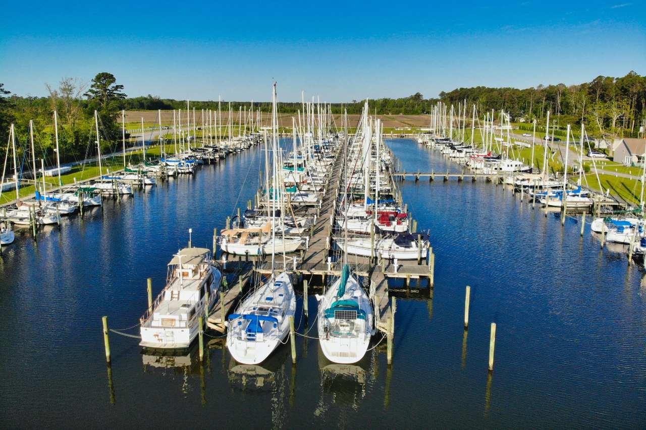 yachts docked at marina